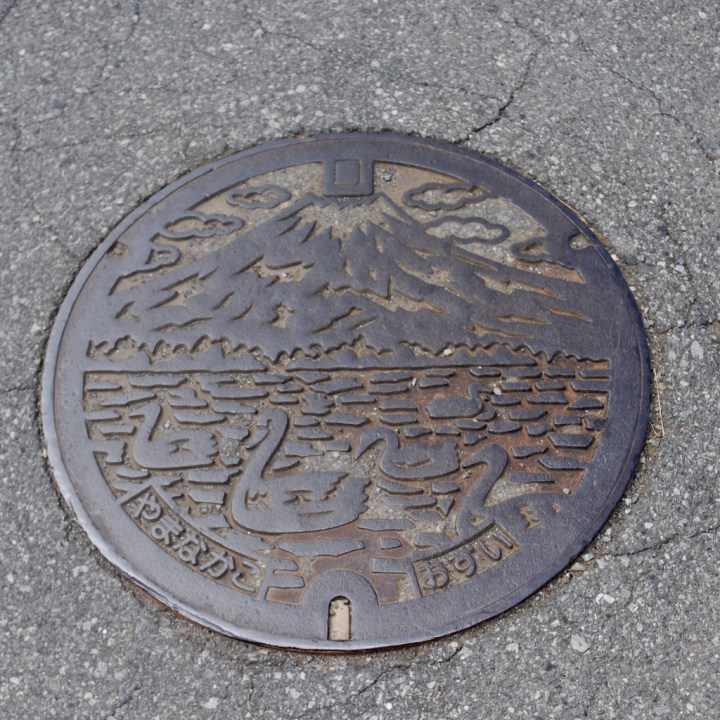 cycling with kids lake yamanakako man hole cover