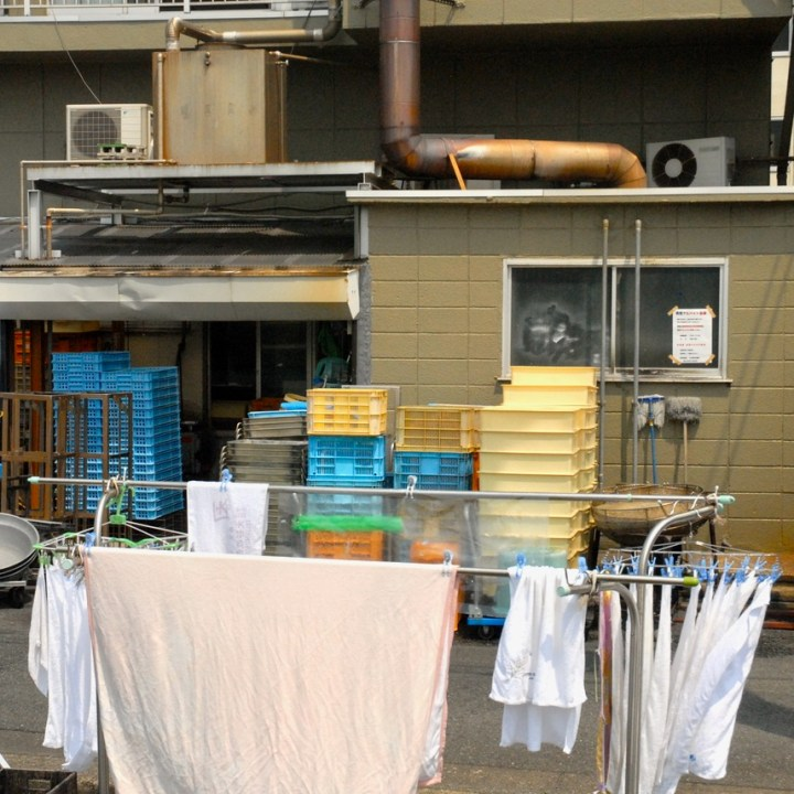 cycling the tame river tokyo japan with kids washing line