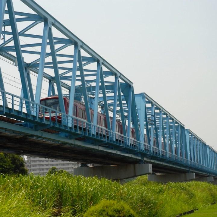 cycling the tame river tokyo japan with kids train bridge
