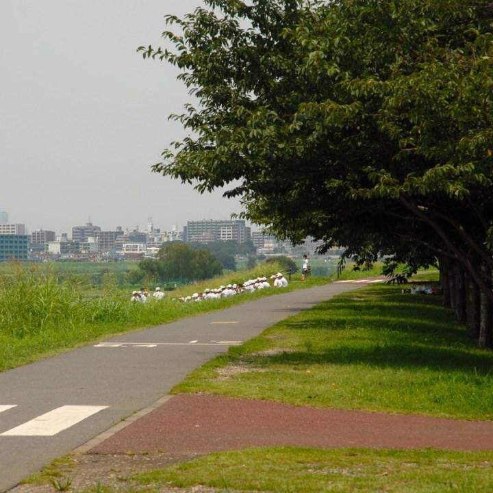 cycling the tame river tokyo japan with kids baseball team