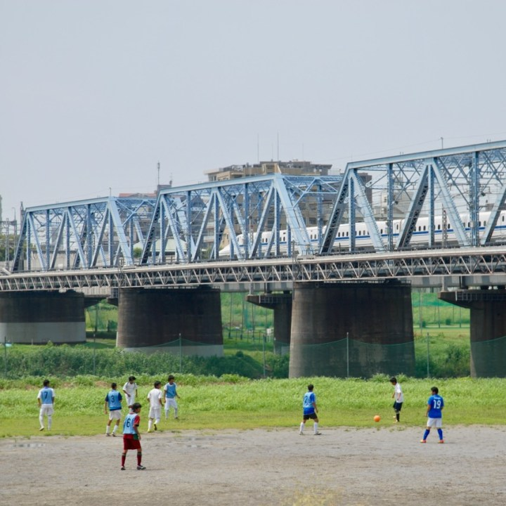 cycling the tame river tokyo japan with kids football game