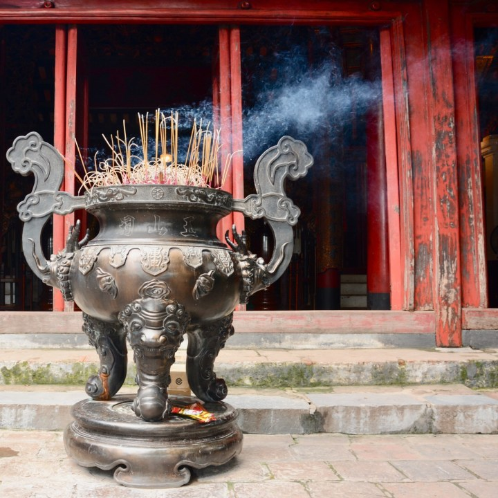 travel with kids vietnam hoi an temple incense
