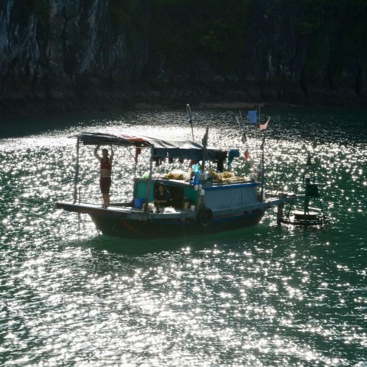 vietnam with kids ha long bay fisher men