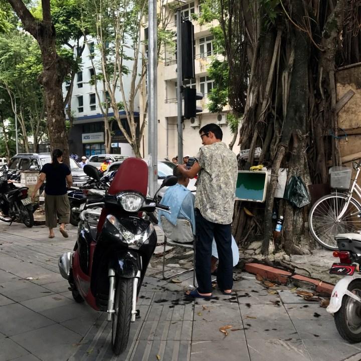 travel with kids vietnam hoi an street barber