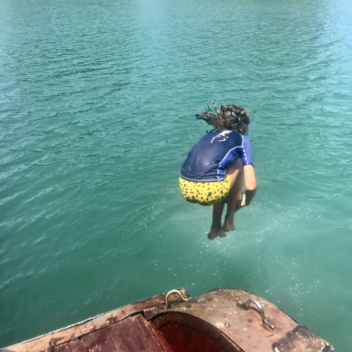 vietnam with kids ha long bay jumping in