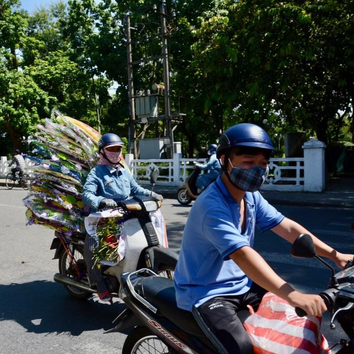 vietnam with kids hue market motorbikes