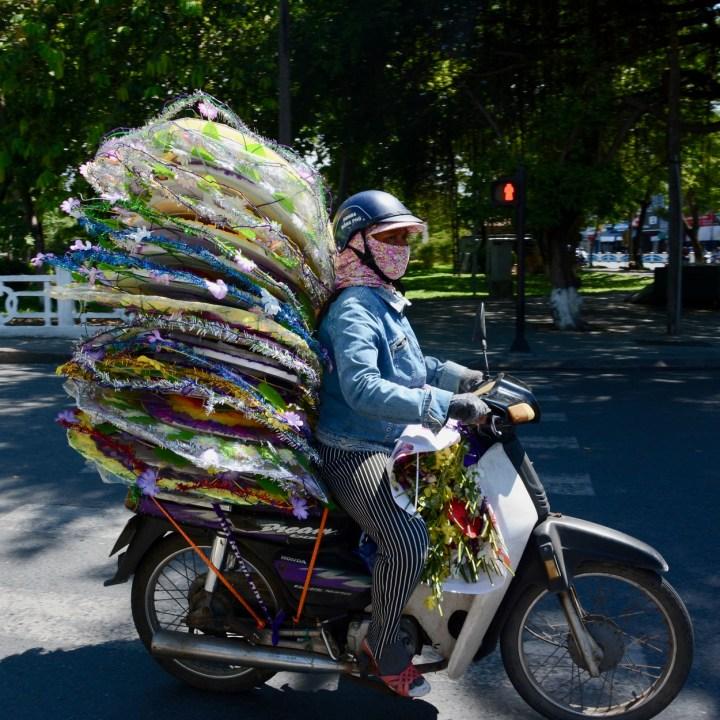 vietnam with kids hue market loaded motorbike