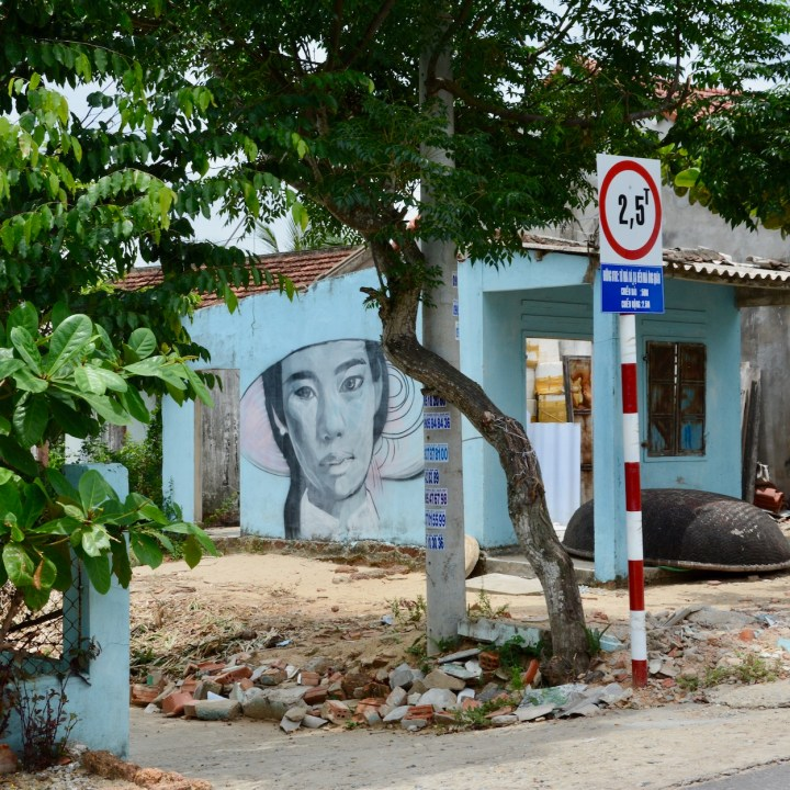 travel with kids vietnam tam than art village lady