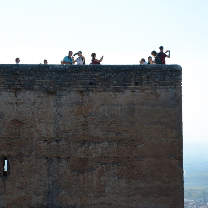 alhambra with kids alcazaba tower tourists