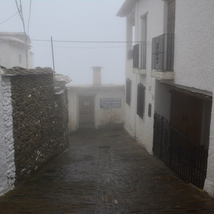 bubion with kids foggy streets
