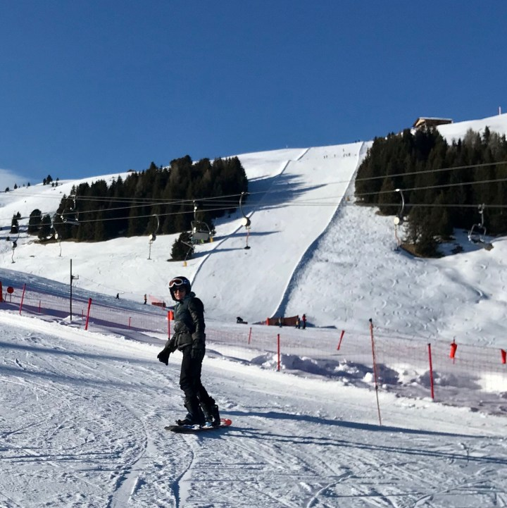 seiser alm skiing with kids snowboarder