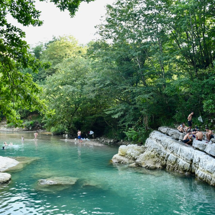 Exploring Georgia with kids Martvili Gorge swimming with locals