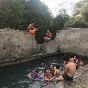 Atskuri castle Georgia with kids swimming with the locals