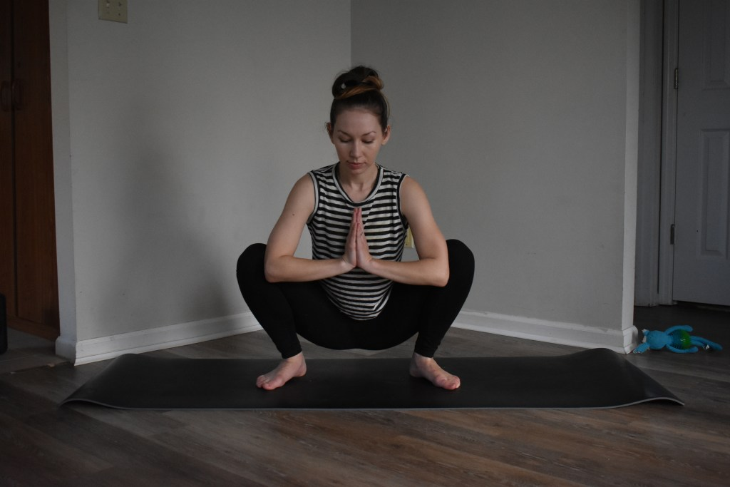 squat malasana yoga wanderly blog