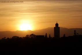 Marrakech - Sonnenaufgang hinter dem Hohen Atlas und der Koutoubia