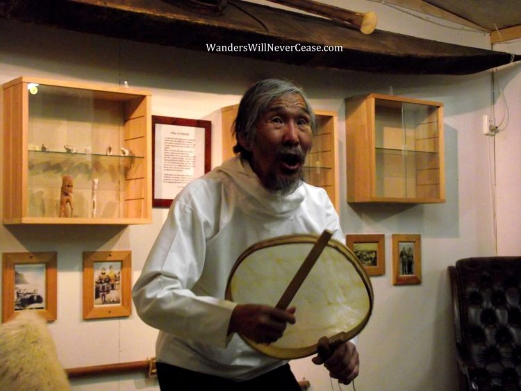 Kulusuk man playing drum in Greenland