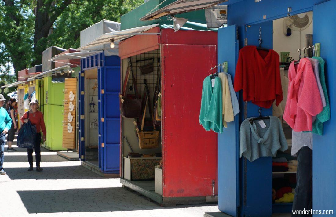 Artisans de la Cathedrale colorful booths. Quebec City shopping artisan souvenirs.