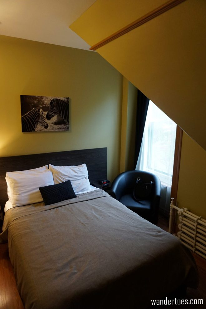 Hotel room, seating chair and window. Manoir de la Terrasse Quebec City Canada Review