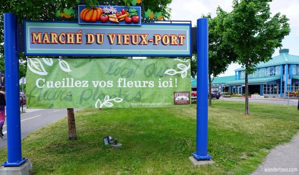 Marche du Vieux Port entrance sign.  Quebec City shopping artisan souvenirs.