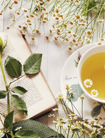 book and flowers with tea