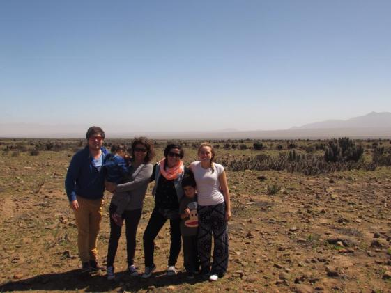 a family of all nationalities standing together in the desert of Chile