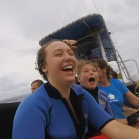 two people screaming on a boat