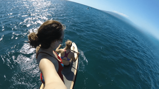 2 people exploring on a SUP board