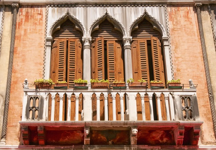 Shutters and balcony of building in Venice, Italy