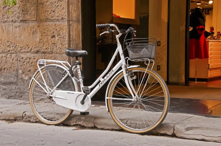 Bike in front of shop, Florence, Italy