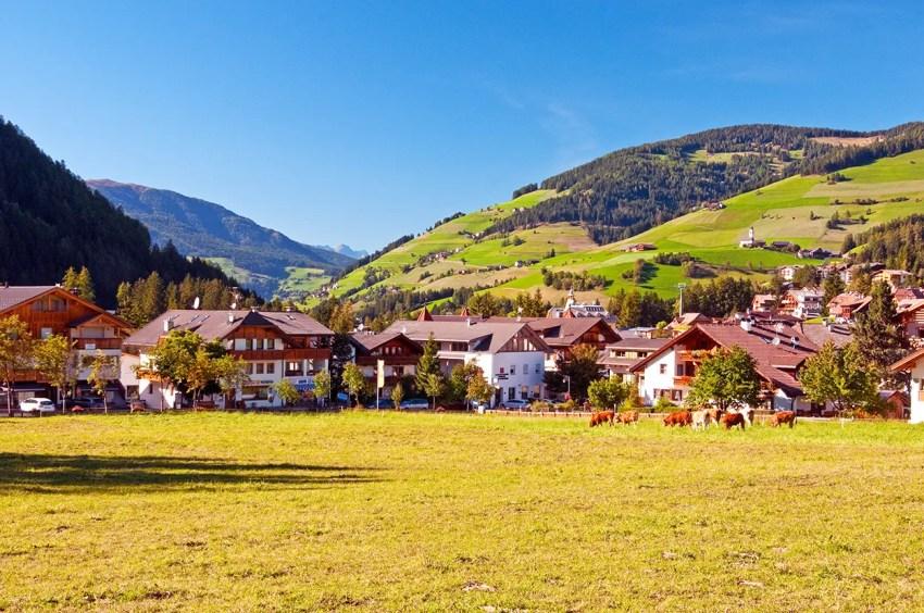 Looking across field in the village of San Vigilio di Marebbe, Italy