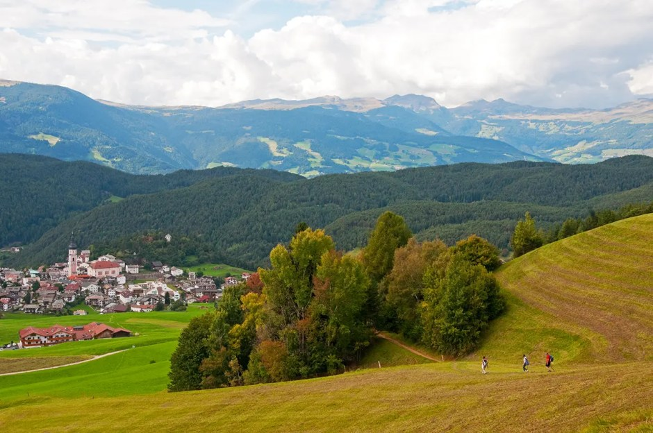 Mountains, valley, trail and Castelrotto/Kastelruth, Italy