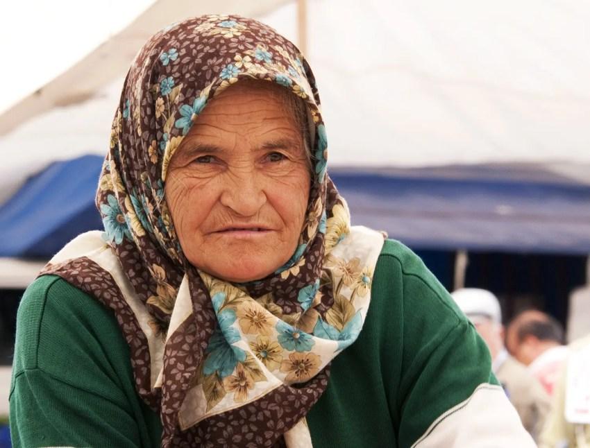Elderly woman making Gšozleme, Kalkan, Turkey