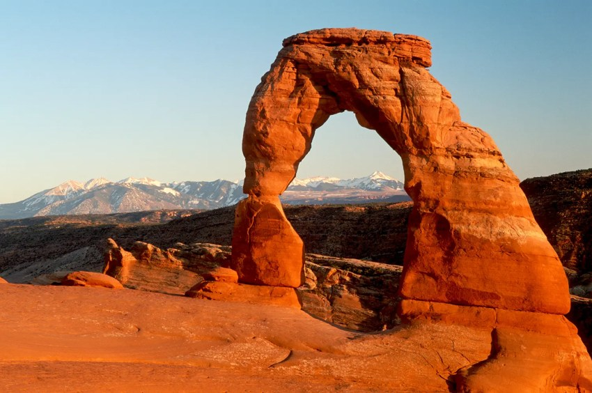 Delicate Arch with the La Sal Mountains in the background, sunset, Arches National Park, Moab, Utah, USA