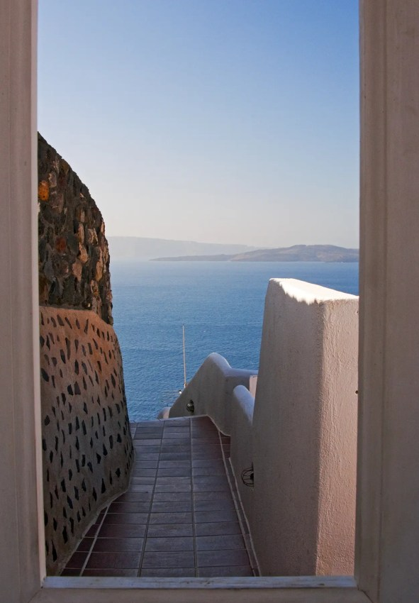View through doorway to Aegean Sea, Oia, Santorini, Greece