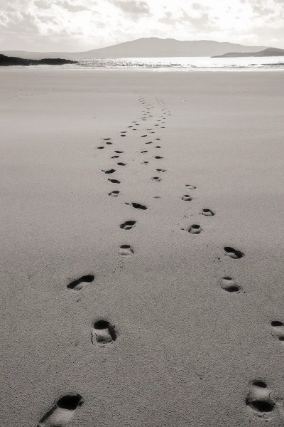 Footprints in sand, beach near Kildoon, County Mayo, Ireland