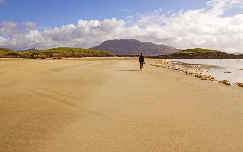My friend walking down the beach in County Mayo, Ireland