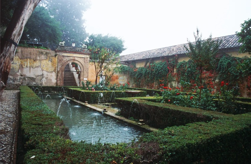 Patio with pool in the Generalife Gardens of the Alhambra, Granada, Spain