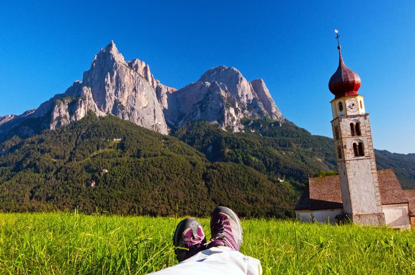 View of the Dolomites from meadow in Alpe di Siusi area, near the town of Suisi, Italy