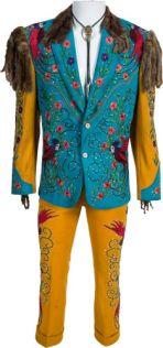 "Costume porté dans le film "" Rhinestone"" : $1,000"