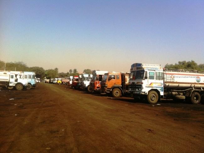 Road leading to Sewri jetty with Petroleum trucks on both sides - sewri jetty flamingos