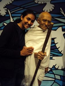 thats me with Mahatma Gandhi at the Madame Tussauds in London - celebrity wax museum