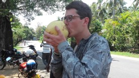 Ben drinking a king coconut