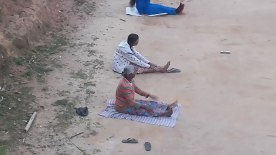 Very old villagers of Koradekumbura doing physical exercises in the village playground.