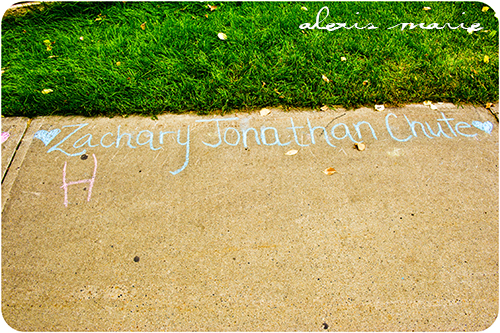 My daughter Hannah found Zachary's name. She wrote an H to signify her love.  Photograph copyright Alexis Marie Chute
