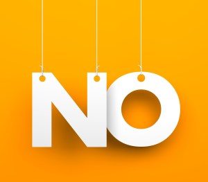 """The word """"NO""""is hanging by ropes. the background is orange"""