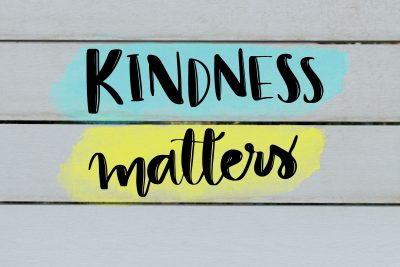 Kindness matters inspirational message on grey wooden background