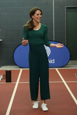 britains-catherine-duchess-of-cambridge-tries-out-the-news-photo-1582729781