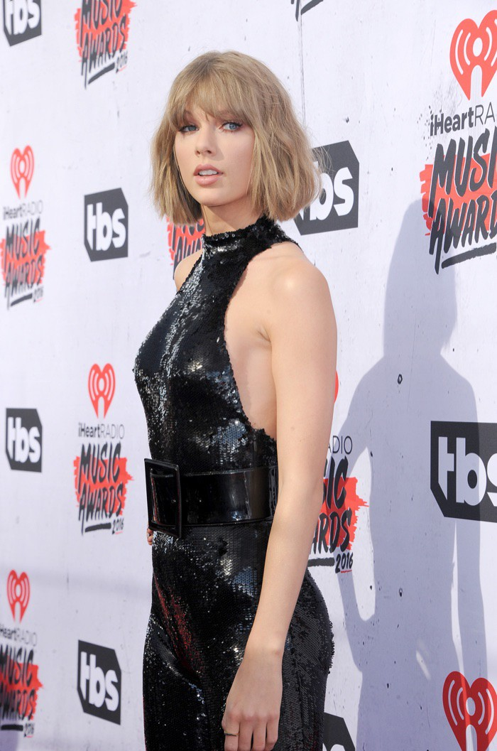 WTFSG_Taylor-Swift-Black-Sequin-Saint-Laurent-Jumpsuit-iHeart-Radio-2016_2