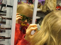 She thought the funky glasses were cool. Her favourites seemed to be the bunny (above) and the kitty. She would run and quick peek in the mirror, and grin just a bit, before throwing the glasses back on the stand.