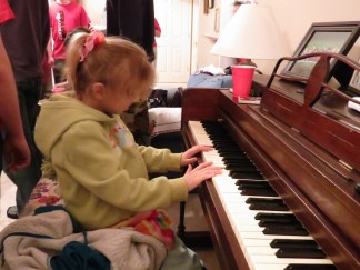 Katya decided to play the piano, treating us to snatches of Chopsticks and a few five-finger scales.